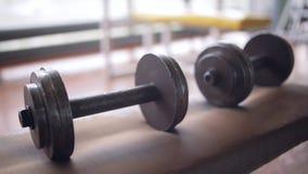 Handmade metall dumbbells stock footage