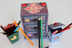A handmade mini chest of three drawers decoupaged with floral vintage paper, handmade objects decorated using different techniques. Of decoupage Stock Photos