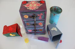 A handmade mini chest of three drawers decoupaged with floral vintage paper, handmade objects decorated using different techniques. Of decoupage Stock Images