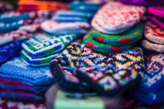 Handmade mittens on the fairground. Handmade mittens on a fairground Royalty Free Stock Photography