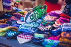 Handmade mittens on the fairground. Handmade mittens on a fairground Stock Images