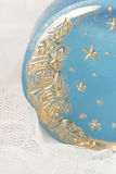 Handmade moon soap. Close-up of handmade blue soap with golden moon Stock Image