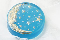 Handmade moon soap. Handmade blue soap with golden moon Royalty Free Stock Photography