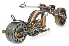 Handmade motorcycle, chopper, cruiser composed of metal parts, b. Handmade motorcycle, chopper, cruiser made of metal parts, bearings, screwdrivers, motor Stock Photos