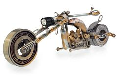 Handmade motorcycle, chopper, cruiser composed of metal parts, b. Handmade motorcycle, chopper, cruiser made of metal parts, bearings, screwdrivers, motor Royalty Free Stock Image
