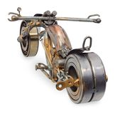 Handmade motorcycle, chopper, cruiser composed of metal parts, b. Handmade motorcycle, chopper, cruiser made of metal parts, bearings, screwdrivers, motor Royalty Free Stock Images