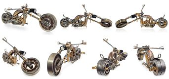 Handmade motorcycle, chopper, cruiser composed of metal parts, b. Handmade motorcycle, chopper, cruiser made of metal parts, bearings, screwdrivers, motor Royalty Free Stock Photography