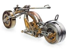 Handmade motorcycle, chopper, cruiser composed of metal parts, b. Handmade motorcycle, chopper, cruiser made of metal parts, bearings, screwdrivers, motor Royalty Free Stock Photo