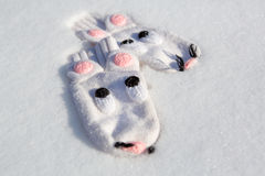 Mouse pattern gloves on winter snow Royalty Free Stock Photography