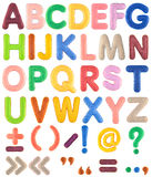 Handmade multicolor Alphabet set with punctuation marks from felt. Handmade multicolor A-Z Alphabet set with punctuation marks from felt on white background royalty free stock photo