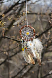 Handmade native american dream catcher on background of rocks an Stock Images