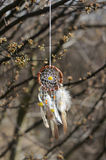 Handmade native american dream catcher on background of rocks an Royalty Free Stock Images
