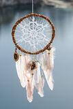 Handmade native american dream catcher on background of rocks an Stock Photography