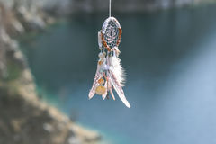Handmade native american dream catcher on background of rocks an Royalty Free Stock Photo