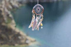 Handmade native american dream catcher on background of rocks an Stock Photo