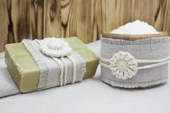 Handmade, natural organic olive oil soap and cosmetic salt on linen background. Spa bath accessories, feminine care products. Hygi. Ene concept photo. Herbal Royalty Free Stock Photography
