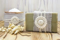 Handmade, natural organic olive oil soap and cosmetic salt on linen and wooden background. Spa bath accessories, feminine care pro. Handmade, natural organic Stock Images