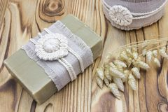 Handmade, natural organic olive oil soap and cosmetic salt on wooden background. Spa bath accessories, feminine care products. Hyg. Handmade, natural organic Royalty Free Stock Photos