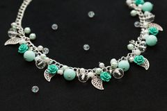 Handmade necklace with beads, flowers and leaves Royalty Free Stock Images