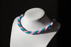 Handmade necklace from beads of three colors Royalty Free Stock Photo