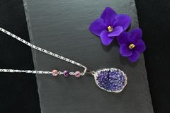 Handmade necklace with druzy violet agate Royalty Free Stock Image