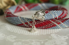 Handmade necklace on a textile background Stock Images