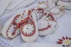 Handmade needlework socks / bootee. Some handmade needlework socks / bootees for kids Royalty Free Stock Image