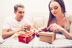 Handmade New Year decor presents couple in love making together Royalty Free Stock Photos