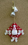 Handmade New Year talisman obereg with snowman and bells Royalty Free Stock Image