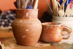 Handmade old clay pots with pencils Stock Photography