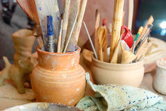 Handmade old clay pots with pencils Royalty Free Stock Photo