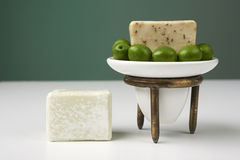 Handmade olive soap with green fresh olives. Royalty Free Stock Images