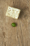 Handmade olive soap with a green olive on wooden table. Stock Images