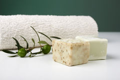 Handmade olive soap with olive branch and a towel. Royalty Free Stock Images