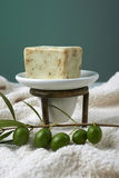 Handmade olive soap with olive branch and a towel. Stock Photo