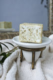 Handmade olive soap with olive branch and a towel. Royalty Free Stock Photo