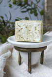 Handmade olive soap with olive branch and a towel. Stock Photos