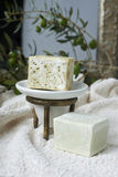 Handmade olive soap with olive branch and a towel. Royalty Free Stock Photography