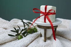 Handmade olive soap with olive branch and a towel, as a gift. Royalty Free Stock Photography