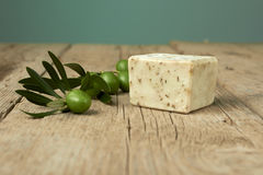 Handmade olive soap with olive branch on wooden table. Stock Photography