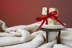 Handmade olive soap with a towel, as a gift. Stock Photos