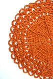 Handmade orange crochet doily Royalty Free Stock Image