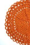 Handmade orange crochet doily Royalty Free Stock Image
