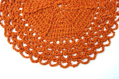 Handmade orange crochet doily Stock Images