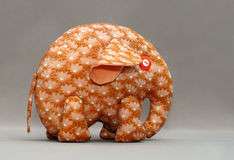 Handmade orange elephant. With buttons for eyes Stock Photo