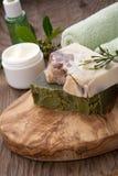 Handmade Organic Soap and Face Cream. Spa set - assorted handmade organic soap, fresh Jasmine flowers, and jar of moisturizing face cream for spa treatment Stock Photos