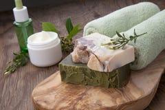 Handmade Organic Soap and Face Cream. Spa set - assorted handmade organic soap, fresh Jasmine flowers, and jar of moisturizing face cream for spa treatment Royalty Free Stock Photos