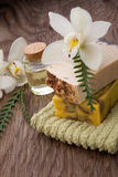 Handmade Organic Soap and Orchids. Spa set - assorted handmade organic soap, massage oil, and white orchids flowers. Best suited for relaxing and health Stock Photos