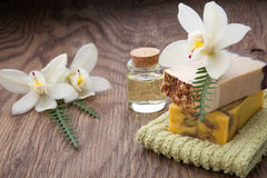 Handmade Organic Soap and Orchids. Spa set - assorted handmade organic soap, massage oil, and white orchids flowers. Best suited for relaxing and health Royalty Free Stock Photo