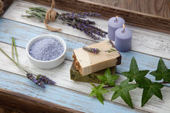 Handmade Organic Soap. Spa set - handmade organic soap, fresh lavender, and bath salt. Scented candles. Best suited for relaxing and health commercials Royalty Free Stock Image